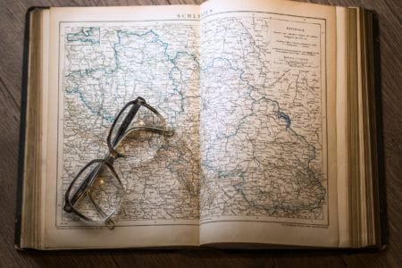black framed eyeglasses map in book